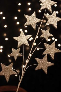 """Silver Glitter Star Pick, by Seasons of Cannon Falls. This silver """"branch"""" of shooting stars covered in super-sparkly silver glitter. We love this tucked into the branches of a Christmas tree, it really catches the light!  Would also work in floral arrangements, or tucked into any winter display.  Measures about 14 inches long.  Made of foam, wire, and glitter. - The Weed Patch www.theweedpatchstore.com #christmas #treepick #starpick #ornament"""