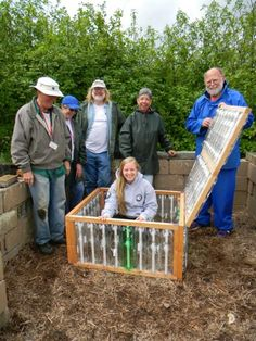 Cold Frame made out of soda bottles -- I think I would prefer hay/straw bales as the side walls or put it on top of a raised bed. Greenhouse Kitchen, Outdoor Greenhouse, Cheap Greenhouse, Greenhouse Effect, Greenhouse Interiors, Backyard Greenhouse, Mini Greenhouse, Greenhouse Plans, Greenhouse Gases