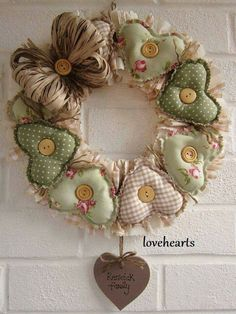 handmade wreath from El taller de Andrea . homespun look with fabric wreaths in pale green prints . wooden buttons and paper ribbon bow . Valentine Wreath, Valentine Decorations, Valentine Crafts, Christmas Decorations, Valentines, Fabric Wreath, Diy Wreath, Burlap Wreath, Sewing Crafts