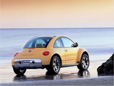 dune bug vw yellow beach