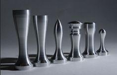 Modern metal chess set turned on a machine lathe