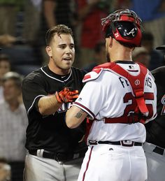 Miami Marlins' Jose Fernandez, left, talks with Atlanta Braves catcher Tyler Flowers after Atlanta reliever Jose Ramirez threw inside to Fernandez during the seventh inning of a baseball game in Atlanta, Wednesday, Sept. 14, 2016. The benches for both teams emptied in the seventh inning after the pitch to Fernandez, who had been knocked to the ground by a pitch from Teheran in the fifth. No punches were thrown and Ramirez was ejected. (AP Photo/David Goldman)