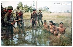 Vietnam War Pictures in Color | South Vietnamese troops with corpses of Vietcong strewn around