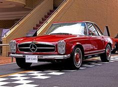 This vintage Mercedes-Benz 280SL is a stunner, right down to the hubcaps. The…