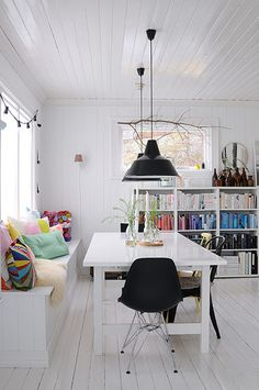 homes - norway house: white room with black shades and black chairs