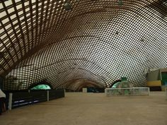 Frei Otto's Multihalle in Mannheim is a beautiful example of a gridshelle structure.