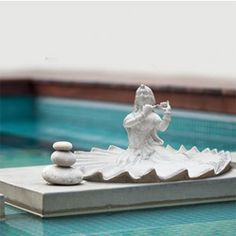 This beautiful dancing woman has been molded and casted using marble slurry material.Place it in your living room, in your garden area, or anywhere you want to relax; this sculpture will definitely add a feel of elegance in your home.