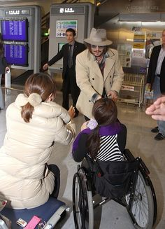 Johnny Depp meeting a young fan in an airport, being and looking cooler than everyone