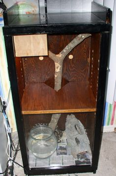 Snake Enclosure.  DIY two story snake enclosure created from a bookshelf. Front hinged door is made from wood frame cut to size and clear acrylic glass.