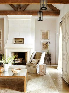 A white fireplace can add a timeless and gorgeous touch to any room. See how these white fireplaces both warm and brighten a room, while emphasizing the shape and design of the hearth. Family Room Fireplace, White Fireplace, Fireplace Design, Fireplace Ideas, Cozy Fireplace, Cozy Living Rooms, My Living Room, Home And Living, Living Spaces