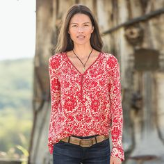 "ESME BLOUSE�--�Adore the vivid print on our gorgeous silk habutai pullover blouse. Scallop lace trim V-neck, hi-lo hem and delicate crochet detail at neckline and cuffs. Dry clean. Imported. Exclusive. Sizes XS (2), S (4 to 6), M (8 to 10), L (12 to 14), XL (16). Front approx. 27""L."