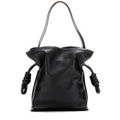 Loewe - Flamenco Knot Small leather shoulder bag - The 'Flamenco' has to be Loewe's most elegant and practical bag yet. The downsized style is covered in smooth black leather with the logo subtly embossed on the top corner. Attention to detail is evident in the knot drawstring detailing and hand-painted edges, not to mention the strap that can be made longer or shorter. Take it everywhere with you: it's an essential accessory. seen @ www.mytheresa.com