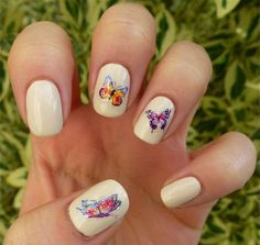 A beautiful collection of butterfly designs perfect for your butterfly nail art design inspiration. The use of a simple white base color is perfect to give life and focus to the highly details and colorful butterflies painted on top. Various color combinations are used with each butterfly having a theme of its own.
