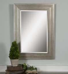 This solid wood frame features a lightly distressed silver leaf finish with black undertones and light gray glaze. Mirror has a generous 1 1/4