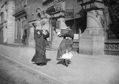 Heavy loads of garments for home-work.  Near Bleeker St., New York, New York, 1912