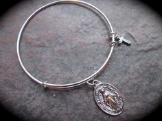 SPECIAL Virgin Mother Mary Miraculous Medal adjustable wire bangle bracelet by HeidiDiCesareDesigns on Etsy https://www.etsy.com/listing/226208970/special-virgin-mother-mary-miraculous