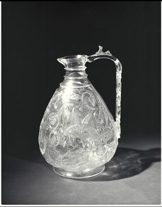 Ewer, (made). Rock crystal ewer with carved decoration, Egypt (probably Cairo), Museum Number The Magnificent Seven, Antique Glass Bottles, Quartz Rock, V & A Museum, Victoria And Albert Museum, Design Museum, Glass Containers, Ancient Egypt, Islamic Art
