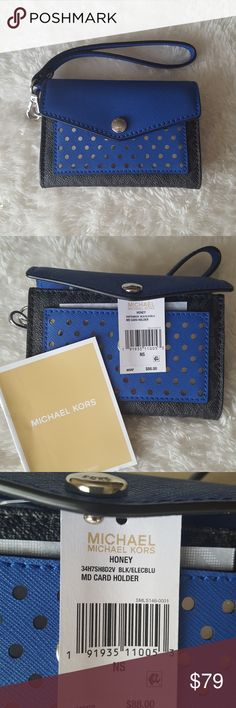 Michael Kors Honey MD Card Holder Brand new with tags Michael Kors MD card holder. Retail price 88. The colors are black and electric blue. Can hold several cards including your ID and some coins. Care card comes with this product. This also contains a wristlet for your arm. MICHAEL Michael Kors Bags Clutches & Wristlets