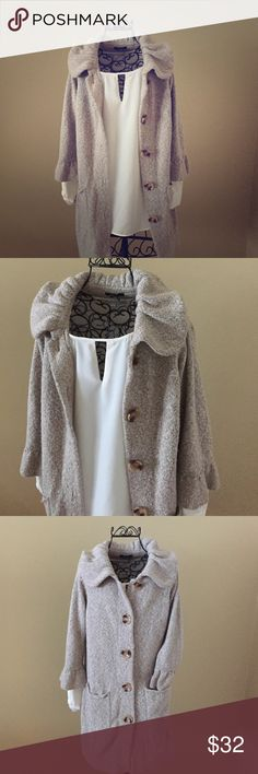 Long Sweater Cardigan Cardigan is longer and has two pockets on the front. There are five big buttons down the front so that cardigan can we worn closed. There is a big collar in he cardigan as well. Cardigan is in fantastic condition!! It is ALFANI and the sleeves are 3/4 length! Alfani Sweaters Cardigans