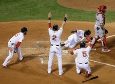 Big Papi scores the third run of a bases-clearing double hit by Mike Napoli in game one of the 2013 World Series