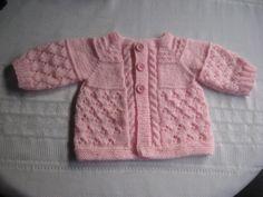 Baby pink cardigan by Soledad Benavente