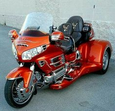 Also for my dream garage. everyone knows the last place I need to be with my balance is holding up a motorcycle, so a trike is the next best thing.though I might go with blue or purple, but this orange is nice.: Motorcycle Trikes, Trike Motorcycle, Ca Honda Motorcycles, Custom Motorcycles, Vintage Motorcycles, Honda Trike, Tricycle, 3 Wheel Motorcycle, Women Motorcycle, Motorcycle Helmets, Goldwing Trike