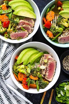 These Miso Sesame Tuna Rice Bowls are a yummy spin on the weeknight stirfry, filled with seared ahi tuna, stir fry veggies in a savoury miso sauce, jasmine rice and sliced avocado!