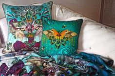 SANTORUS CUSHIONS : Colourful interiors, velvet and linen cushions with bold feathered print.