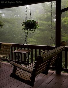 Rainy day porch swing. I could read out here for hours.