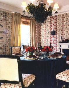 This dining room by Markham Roberts, and table setting would be lovely for Christmas...and year-round.