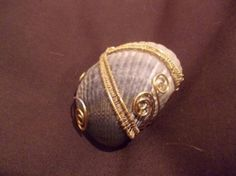 Wire- wrapped shell pendant. |