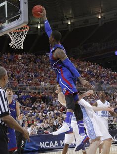 Thomas Robinson jumps for a slam dunk and into Tyler Zeller in the Jayhawks 80-67 victory of North Carolina in the 2012 Elite 8.  kusports.com