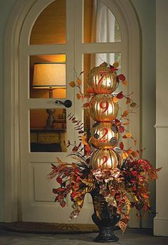 Stacked custom carved pumpkin door greeter from Michaels arts and crafts