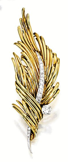 Brooch designed as a feather, embellished by circular-cut diamonds, signed Cartier; mounted in 18 karat yellow gold.