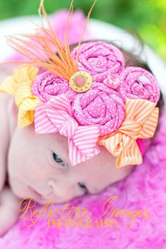 over the top headband, rolled rosettes, sherbet colors, bows and feather
