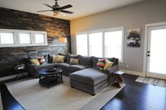 love this sectional and the wood wall from @Erin and Tricia @ Suburban Bitches