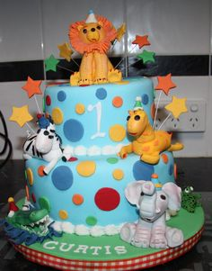 1st Birthday Cake with hand molded animals Choc Mud cake