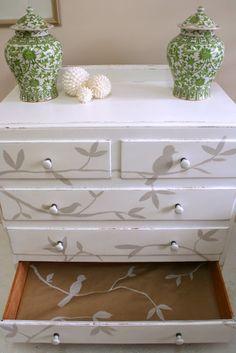dresser with birds