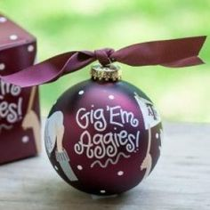 """Go team, go! Kick off the season with the cheer-raising Texas A&M Univeristy Crowd Cheer Ornament! Designed with FAN-tastic """"Gig 'Em Aggies!"""" writing and cheering FAN-atics, it's a high-scoring way to celebrate gameday, holiday or everyday. Personalize it with a name and date for a special spirited keepsake. All collegiate ornaments come boxed and tied with a coordinating ribbon making them the perfect gift for anyone."""