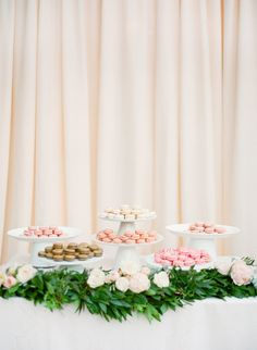 A macaron bar is très chic, the pastel delectables framed by a bed of greenery.
