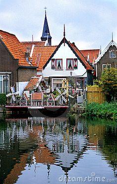Miniature windmills decorate a house in Volendam, Netherlands.