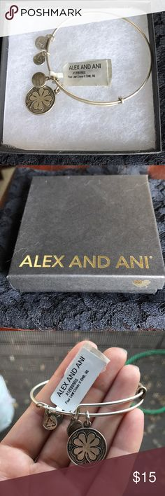 Alex and Ani Bracelet Never been worn, silver four leaf clover bracelet in original box. Needs a little love with a silver polishing cloth, but looks great as is. Alex & Ani Jewelry Bracelets
