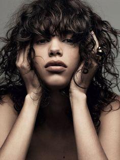 Mica Arganaraz wears her curly hair naturally, shot by Craig McDean
