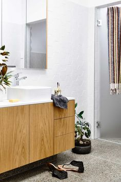 Light timber cabinetry also extends to the main bathroom with feature hexagonal wall tiles Photographer: Derek Swalwell, Stylist: Rachel Vigor Bathroom Plants, Boho Bathroom, Bathroom Trends, Bathroom Colors, Bathroom Styling, Bathroom Storage, Bathroom Interior, Bathroom Ideas, Bathroom Pictures