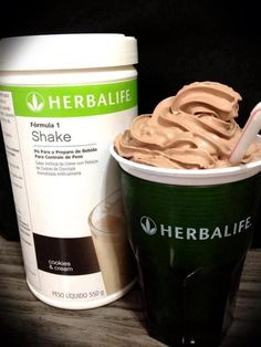 """Chocolate """"Cement"""" Shake 6 oz cold water in blender Add 2 scoops (1 tablespoon per scoop) of Herbalife Chocolate Protein Drink Mix Blend for 2 min. Add 2 scoops Herbalife Formula #1 Cookies & Cream 1/2 tsp Hershey's powdered dark baking chocolate 1/4 tsp vanilla or chocolate extract Blend 1 Min. Add 1 cup ice Blend 2 min. Scrape into a zip lock baggie and freeze 10 min. Cut the end of the baggie with scissors and squeeze into a large cup. 220 calories and 24 g. of protein"""