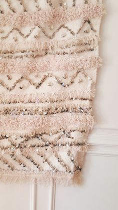 """Handwoven cotton with intricate sequin patterns. Measures 40"""" x 72"""". This vintage textile was handwoven in Morocco. Each wedding blanket is one-of-a-kind with a storied history. It adorned the shoulde"""