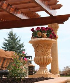 Hand-carved Summer Wheat Limestone planters by Carved Stone Creations.
