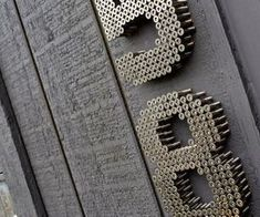 Cray clever Stand off house numbers w/ screws.