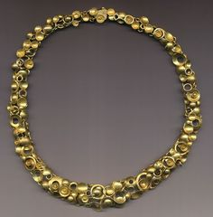 Necklace | Jeff and Susan Wise. 18k gold articulated links with numerous free floating elements.