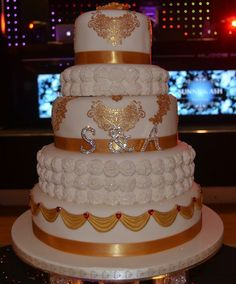 5 tier gold with roses wedding cake